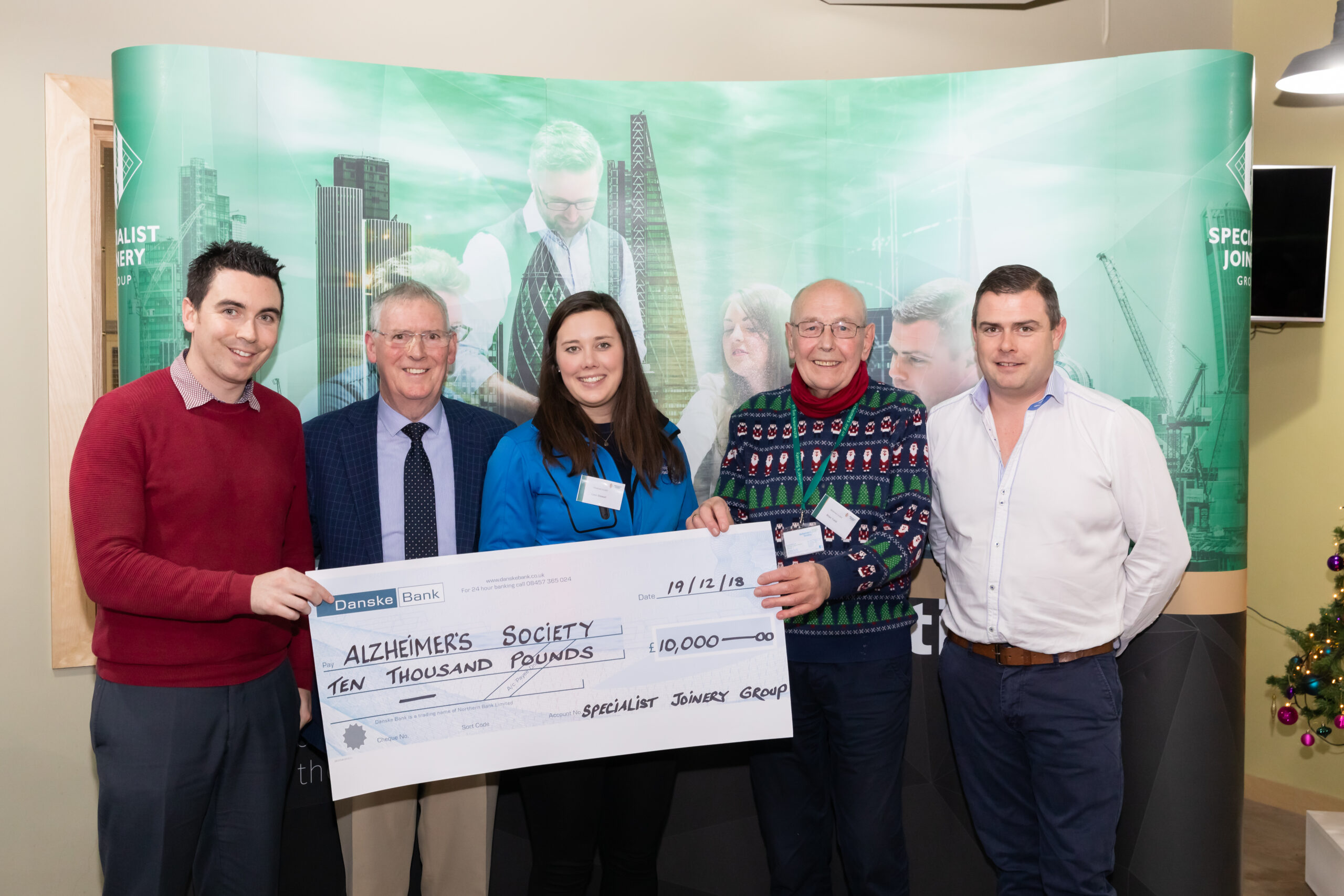 Linzi Stewart and Brian Tohill from Alzheimers Society pictured with Dermot, John Bosco and Ciaran O'Hagan