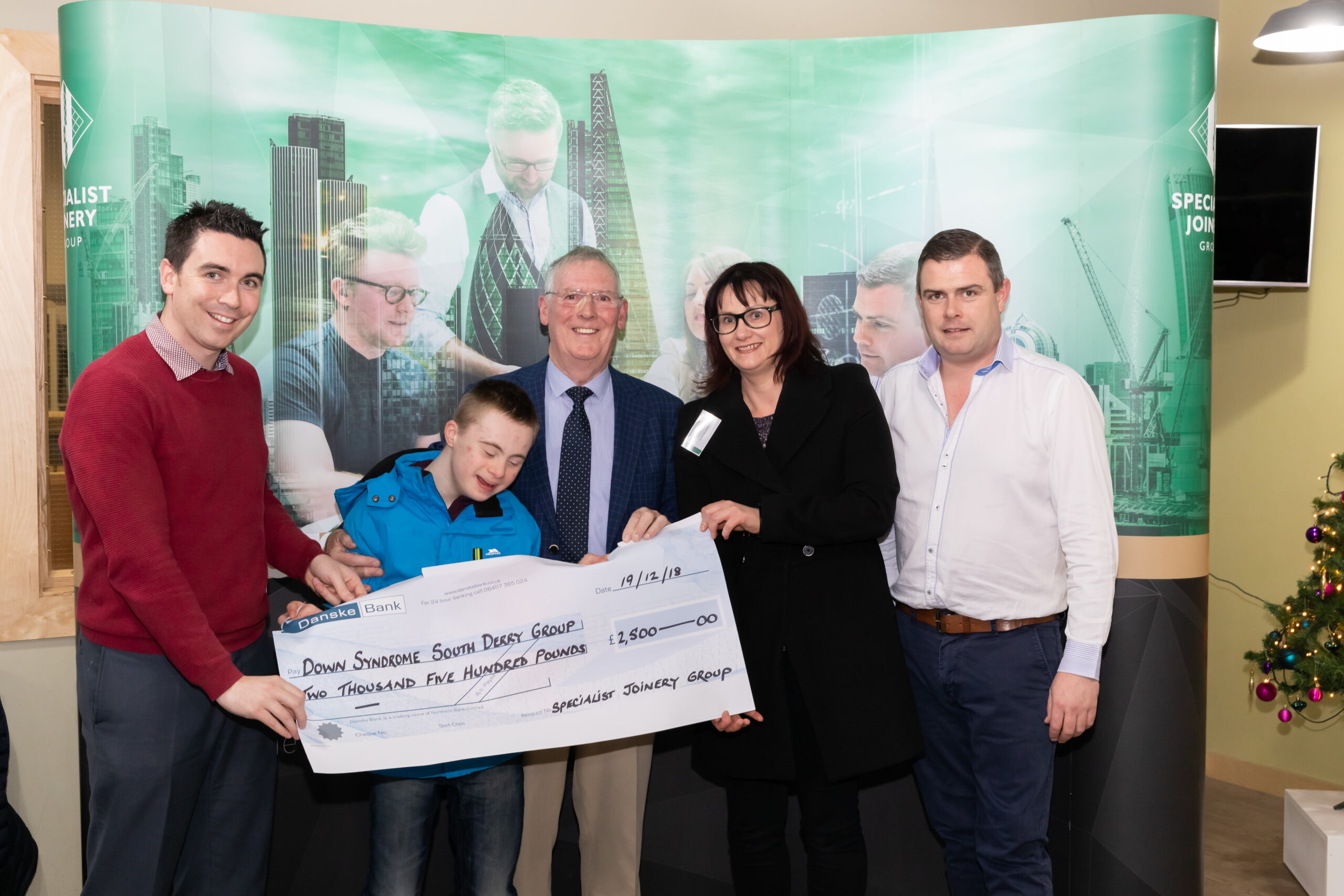 Adrienne and Mark Hutchinson from Down Syndrome South Derry Group pictured with Dermot, John Bosco and Ciaran O'Hagan