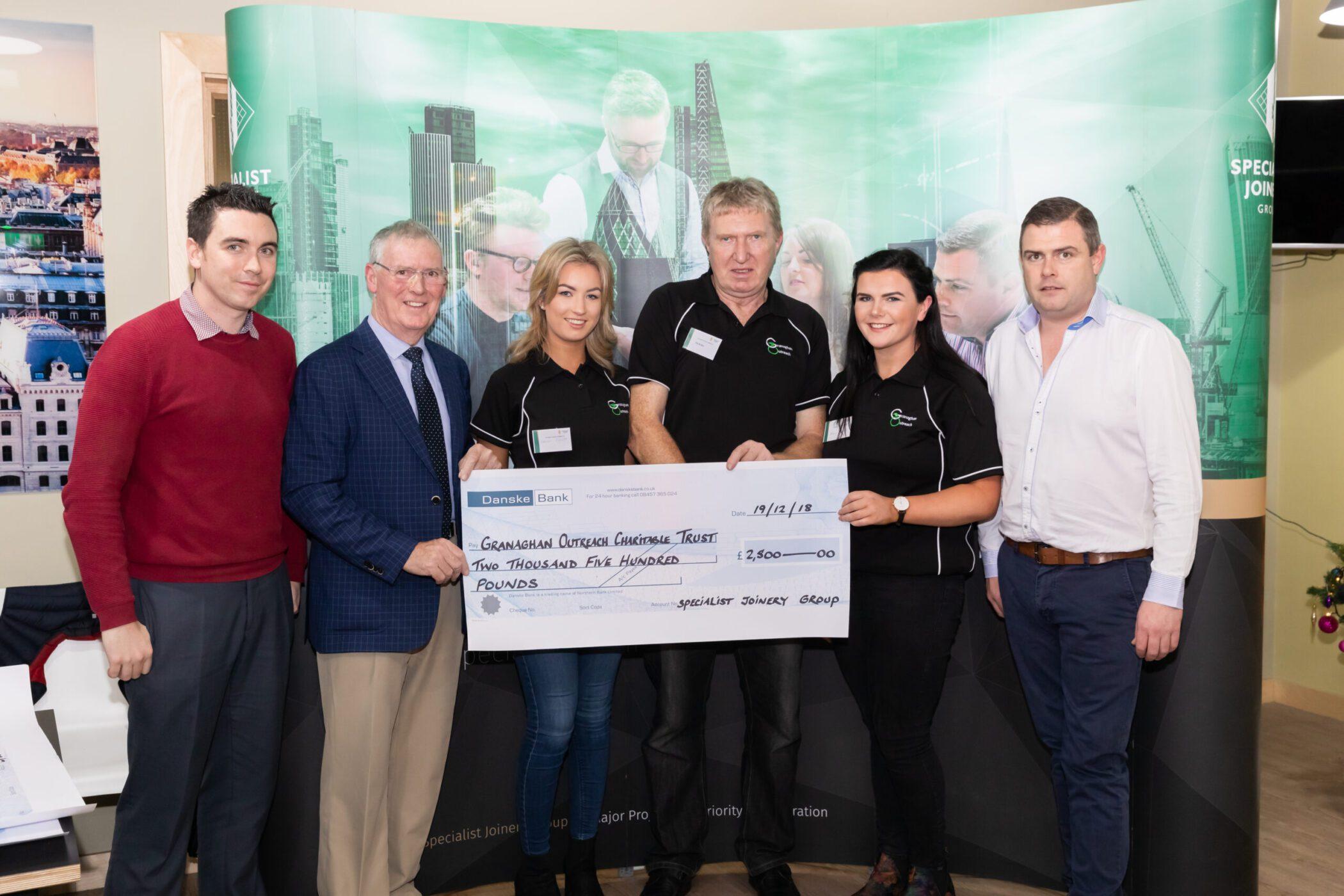 Lauren Elliott, Pat Mullan and Maeve Quinn from Granaghan Outreach pictured with Dermot, John Bosco and Ciaran O'Hagan