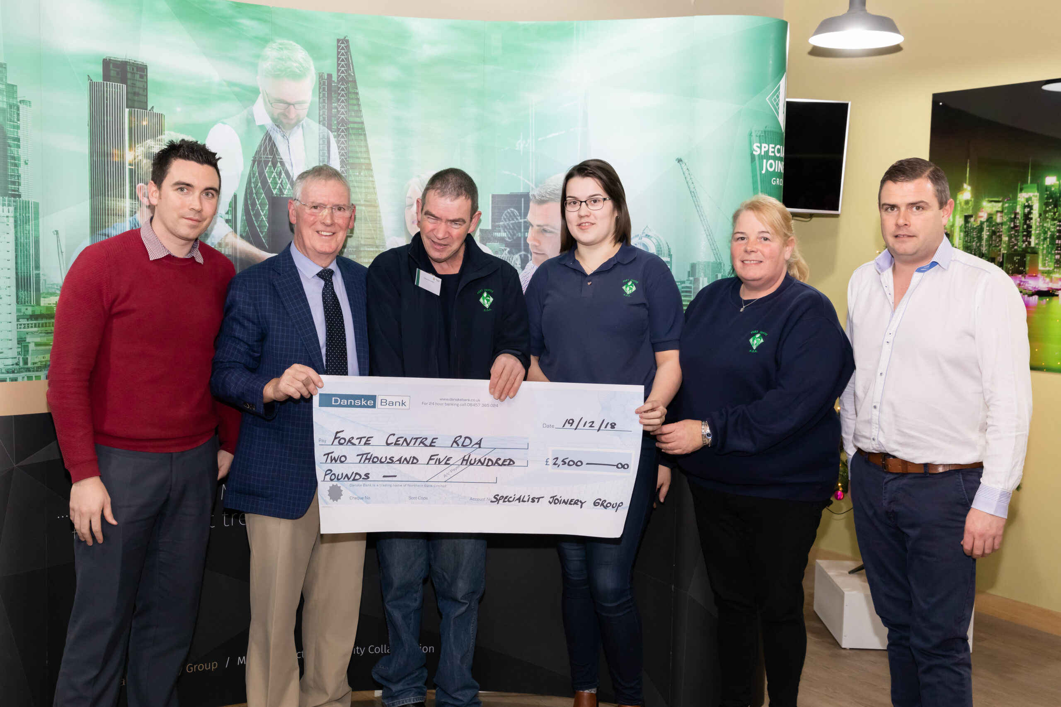 Dermot, John Bosco and Ciaran O'Hagan presenting donation to The Fort Centre RDA
