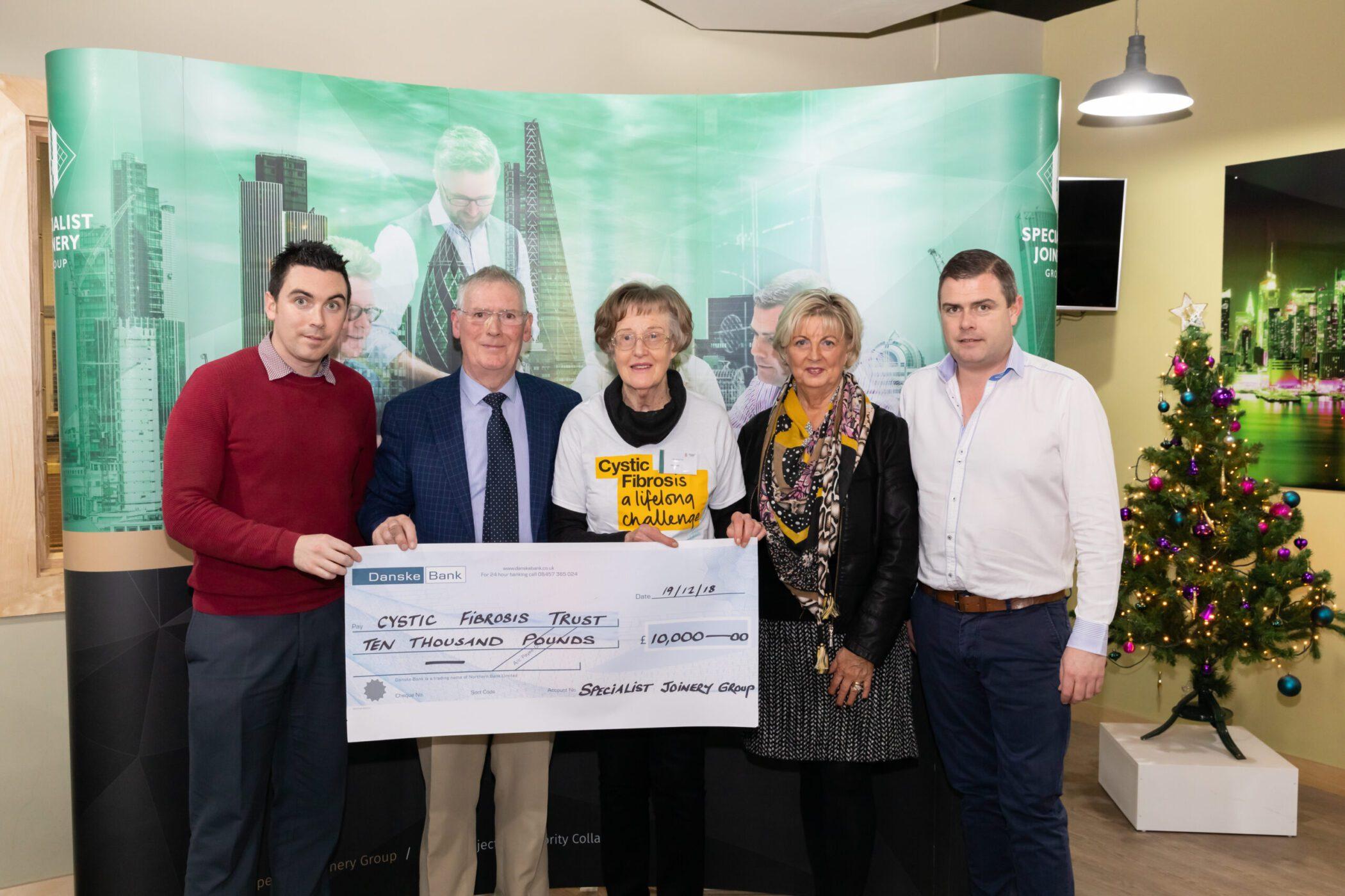 Dermot, John Bosco and Ciaran O'Hagan presenting donation to Cystic Fibrosis Trust