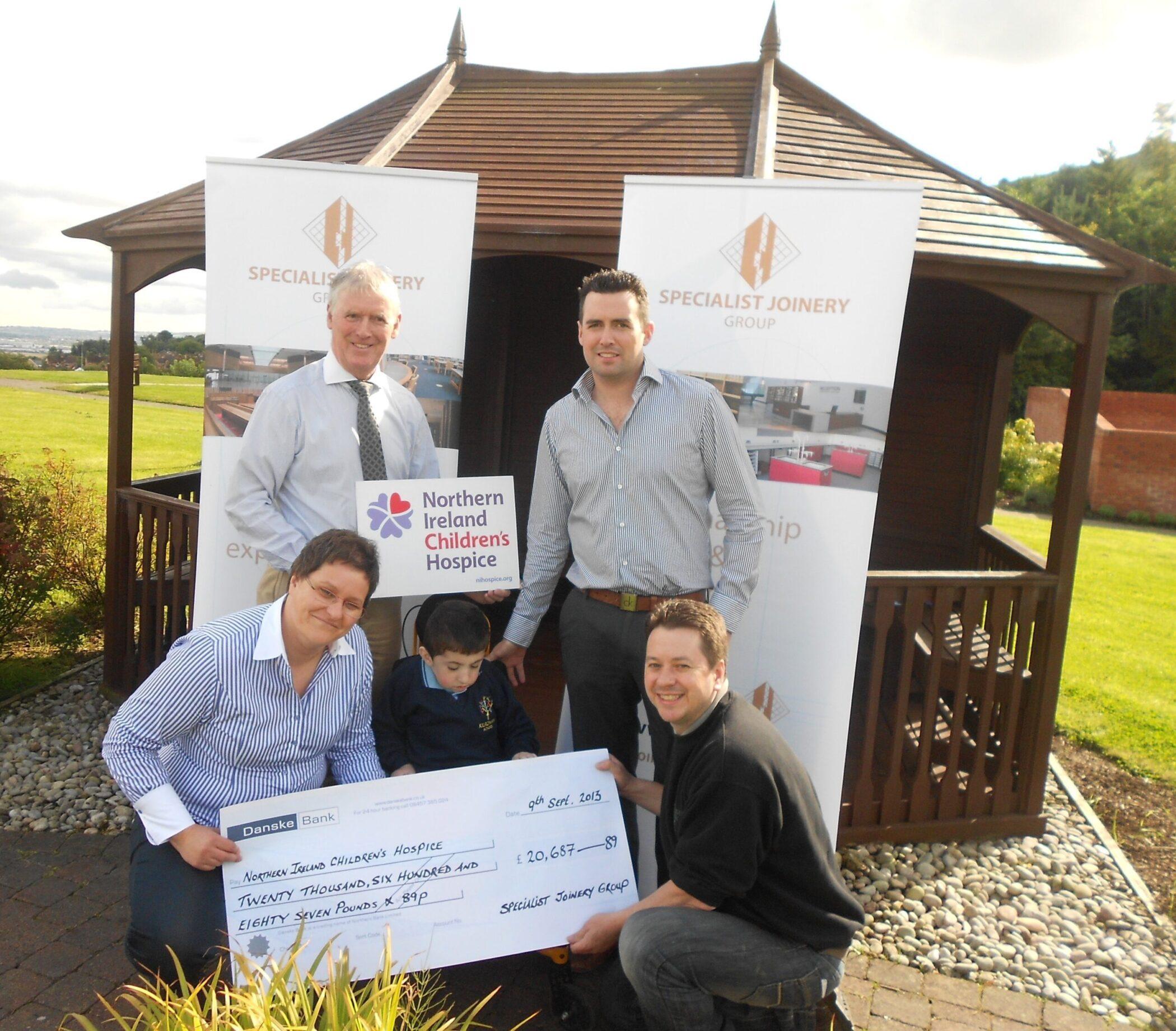 John Bosco and Sean O'Hagan presenting donation of £20,657 to NI Children's Hospice