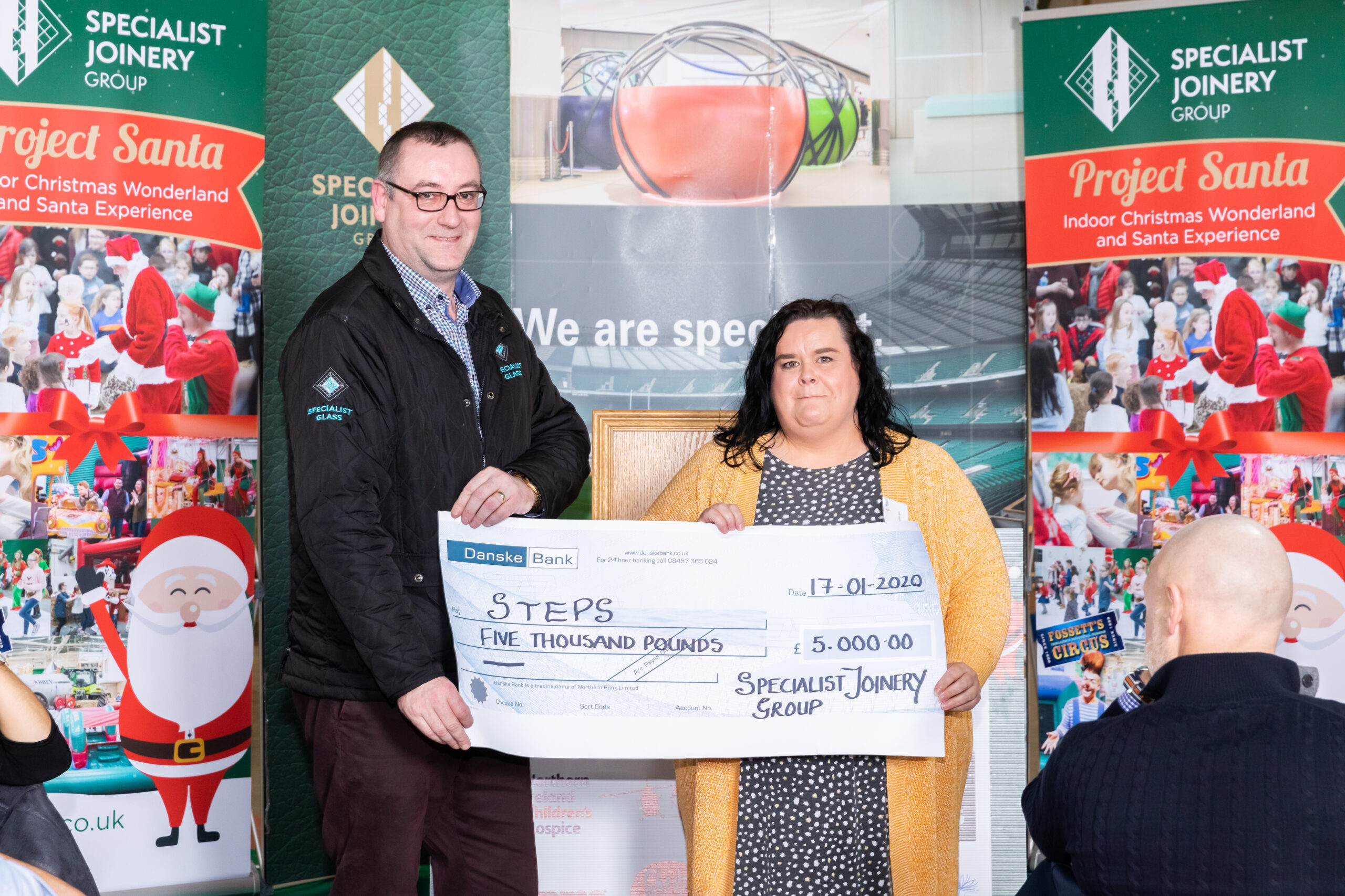 Fearghal McMullan presenting cheque to STEPS