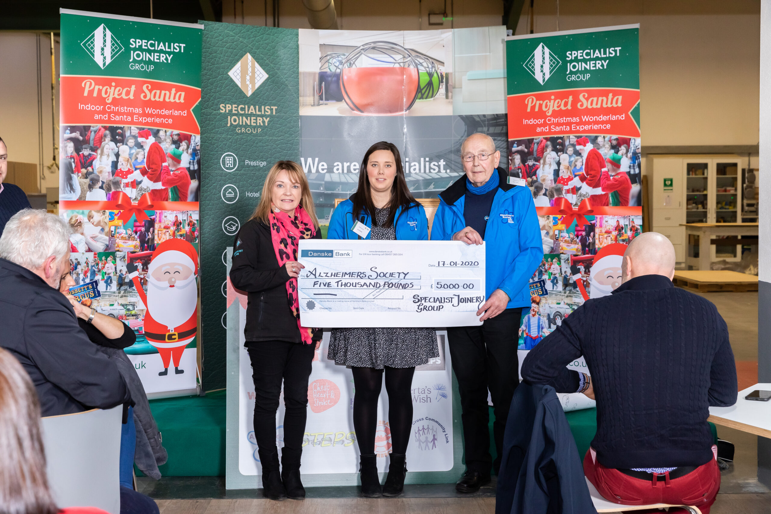 Tracey McMullan presenting cheque to Alzheimer's Society