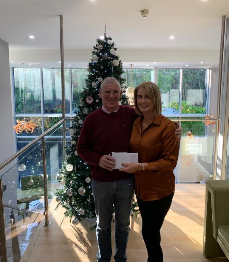 John Bosco O'Hagan presenting donation to St Vincent De Paul